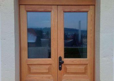 Porte d'entrée double en bois massif (chêne) avec vitrage et imposte